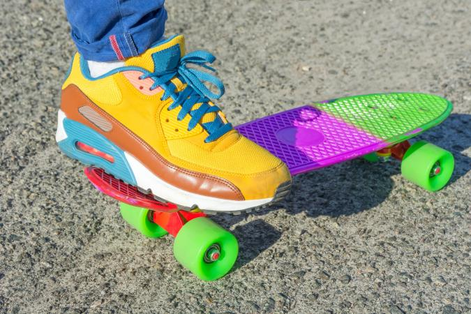 Colorful skateboard and shoe