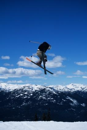 A freestyle skier grabs and flips around