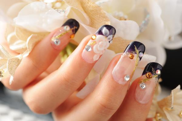 Black-tipped nails with flowers and jewels