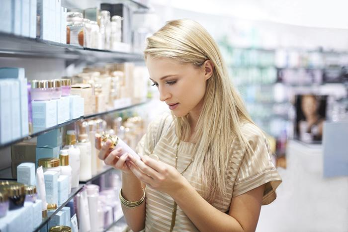 Woman looking at skin care products