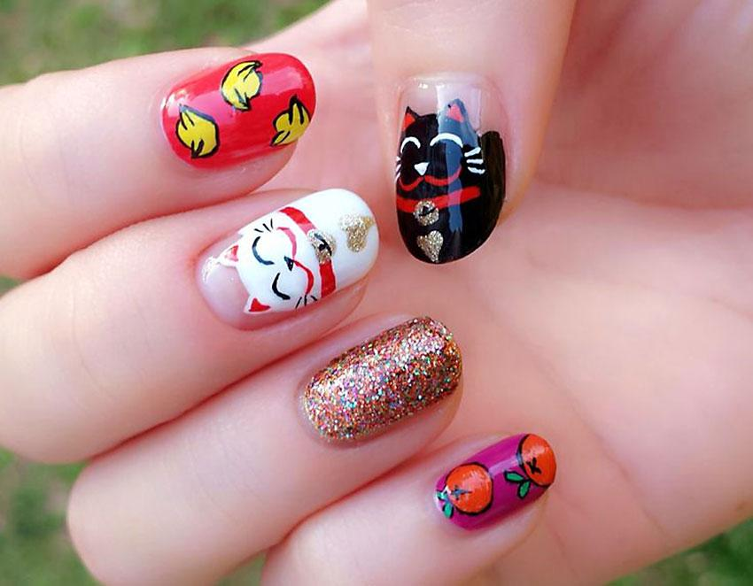 Chinese New Year fortune cat nails from Beautemaniere - Kitty Inspired Nail Art LoveToKnow