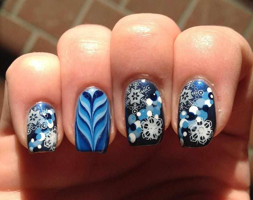 Amazing winter nail designs lovetoknow blue snowflakes nail art prinsesfo Images