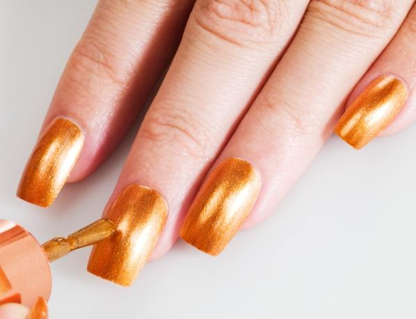 Shiny orange nails