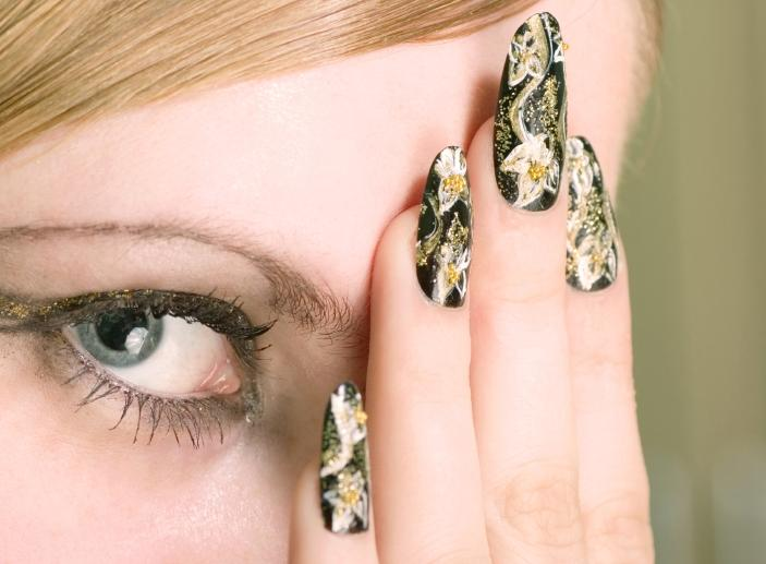 Glitter-dusted, floral on black nail design