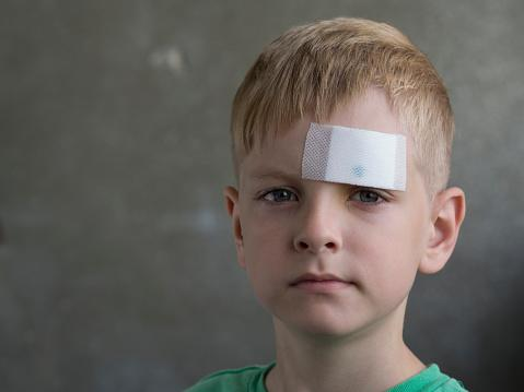Boy With Bandage On Forehead