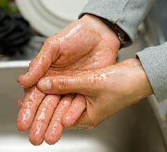 Woman exfoliating hands