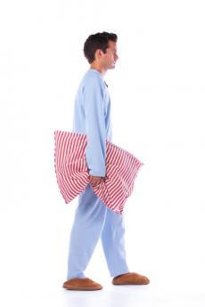 Man with pillow sleepwalking