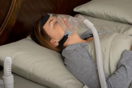 Sleeping woman wearing CPAP mask; © Brian Chase | Dreamstime.com