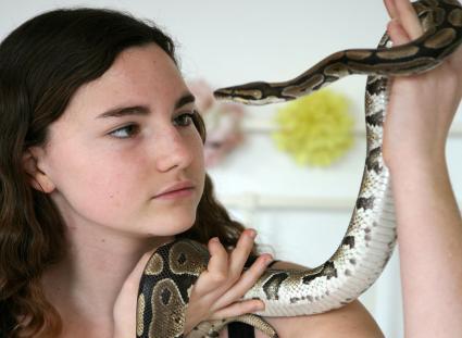 Girl holding a ball python