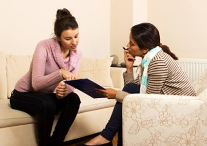 Counselor showing fact sheet to client