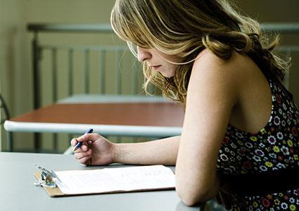 Woman working on worksheet