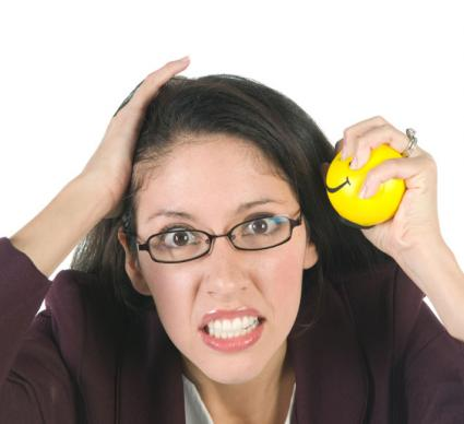 Businesswoman with stress ball