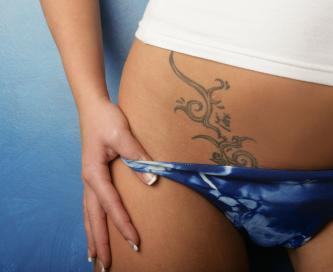 pictures of lower stomach tattoos