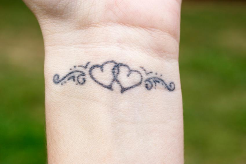 Feminine tattoo photo gallery slideshow for Delicate wrist tattoo designs
