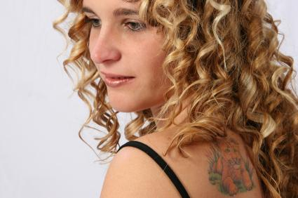 Lion Tattoo on Woman's Shoulder