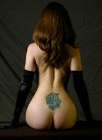 Nude woman with rose tattoo on back