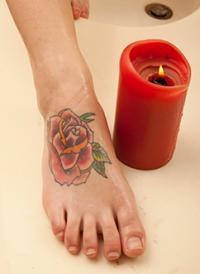 rose tattoo on foot