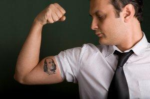 How did prohibiting tattos in workplaces started????????????