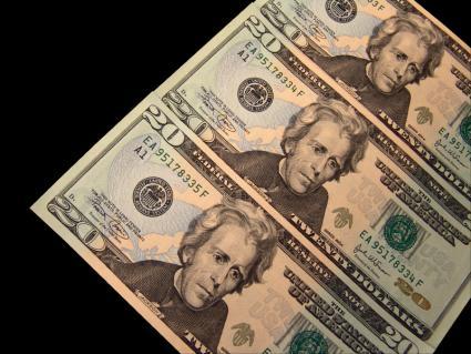 Three, twenty dollar bills