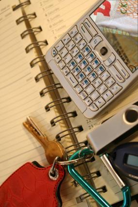 Keys, calculator and notepad