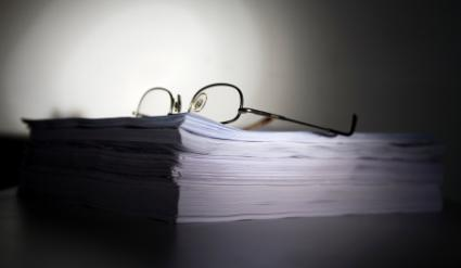 Stack of papers with glasses