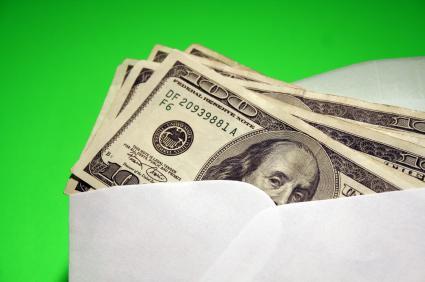 Hundred Dollar Bills in White Envelope