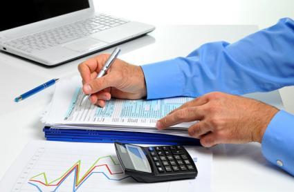 Businessman reviewing tax docs