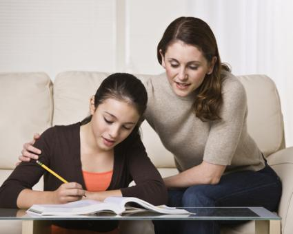 Woman helping daughter with homework; © Jonathan Ross | Dreamstime.com