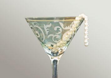 Cocktail and strand of pearls