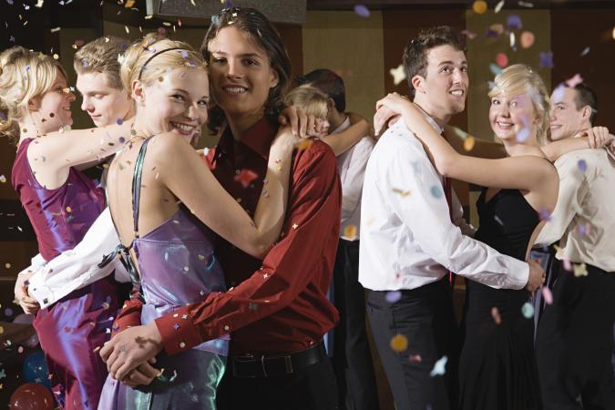 Teenagers slow dancing