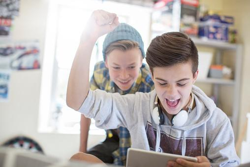teenage boys having fun