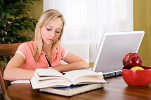 Teen girl at computer