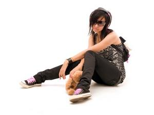 Girl wearing emo clothing while listening to music