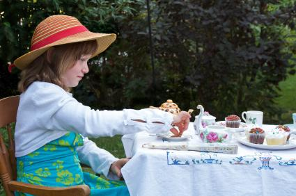 child at tea party
