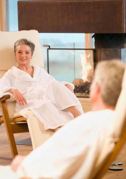 Mature couple wearing robes and relaxing