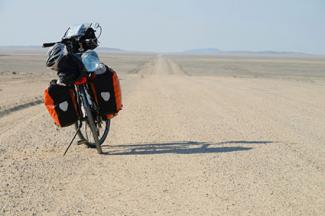 Bike loaded with gear in Namib desert, Namibia