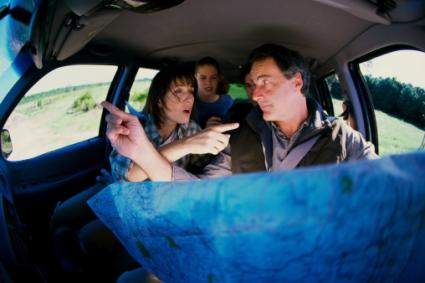 Family looking at map in the car