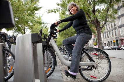 Woman on rental Bicycle
