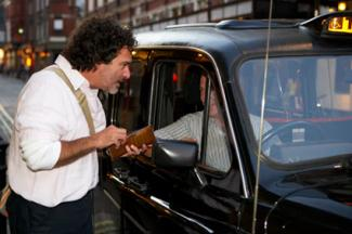 Man tipping taxi driver