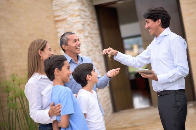 Handing house keys to renters
