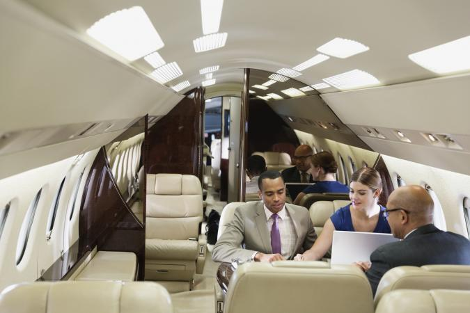 Business people in private jet