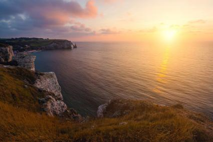 Natural arch of Etretat in Normandy at sunset