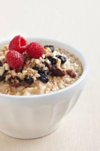 Oatmeal with fresh fruit on top.
