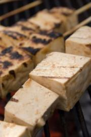 Tofu being grilled.