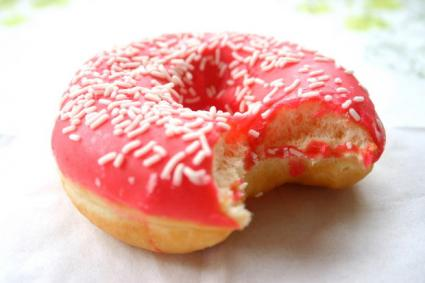 Pink doughnut with sprinkles.
