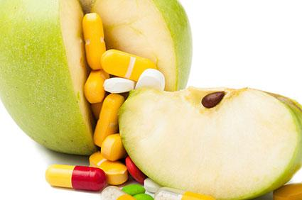 Vitamins and green apple