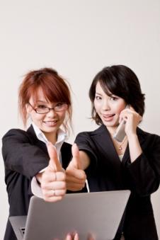 Executives giving thumbs up
