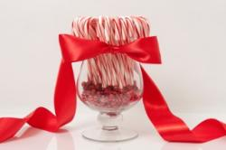 Candy canes in vase with bow