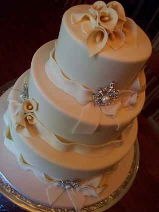 Triple-tier white calla lily wedding cake.