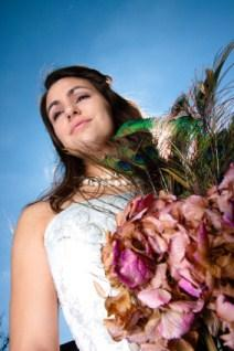 bride with peacock feathers